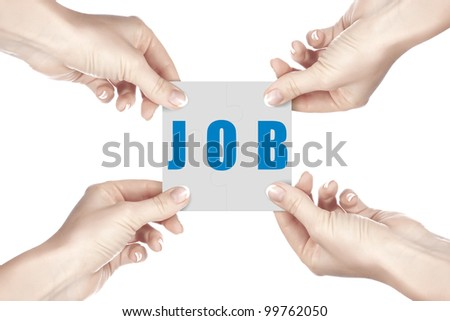 Human hand holding a piece of puzzle with business word