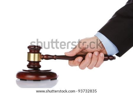 Human hand holding a wooden gavel - stock photo