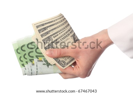 Human hand holding banknotes (euro and dollar) isolated on white