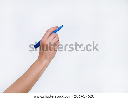 Human hand holding blue ball pen, white background - stock photo