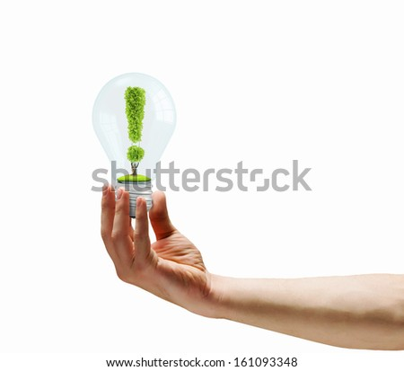 Human hand holding bulb with exclamation sign - stock photo