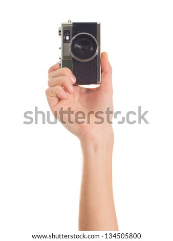 Human Hand Holding Camera On White Background