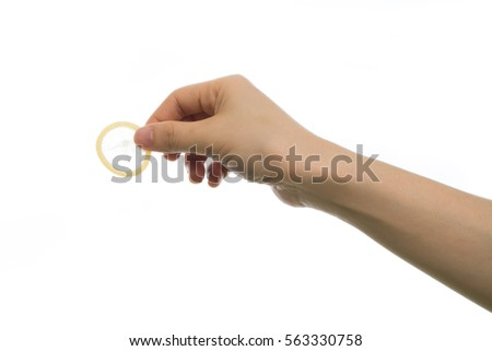 human hand holding condoms on isolated white background. concept of protection sexual young in valentine's day.