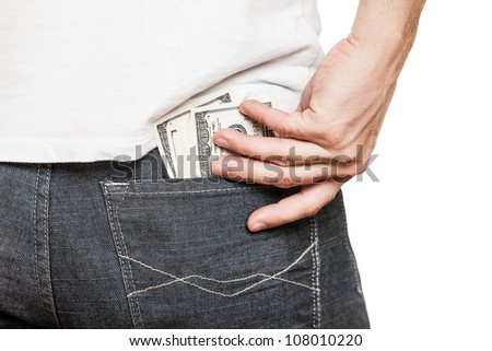 Human hand holding dollar currency cash taking banknote out of jeans pocket - stock photo