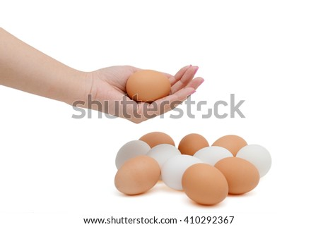 Human hand holding egg on white background