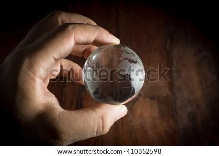 Human hand holding globe. - stock photo