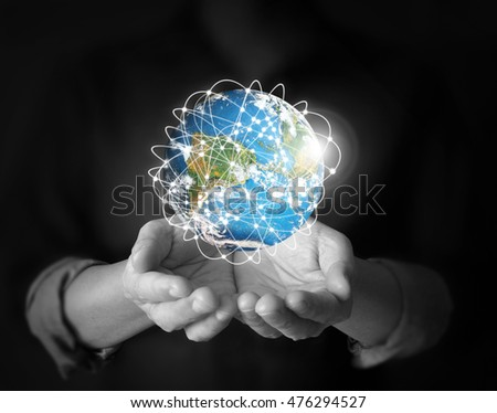 Human hand holding globe Elements of this image furnished by NASA