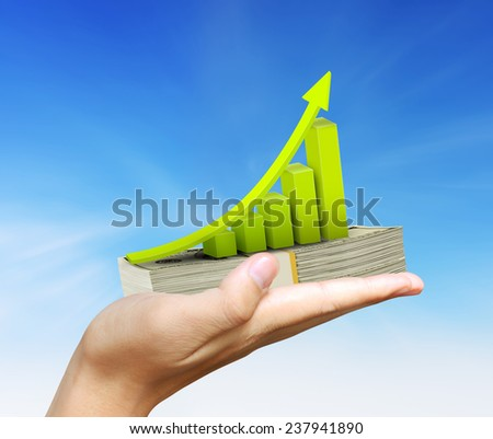 Human hand Holding graph and money - stock photo
