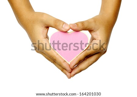 Human hand holding heart shape wooden sign isolated over white background. You can put your design here
