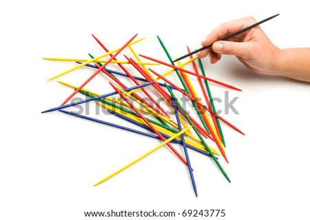 human hand holding helper black mikado stick - stock photo
