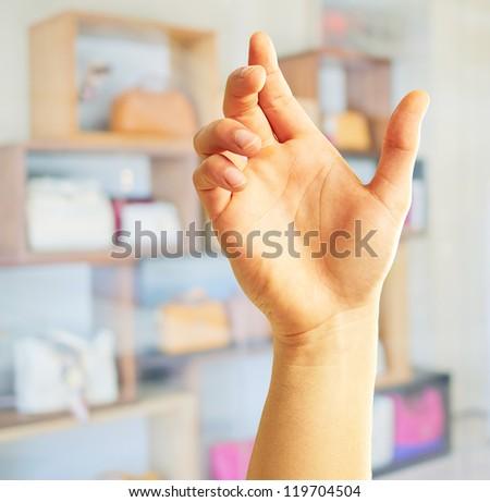 Human Hand Holding, Indoor - stock photo