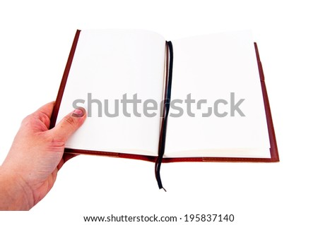 Human hand holding notebook with Leather Cover to write something, isolated on white background / concept and idea. - stock photo