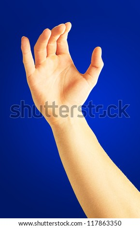 Human Hand Holding On Blue Background - stock photo