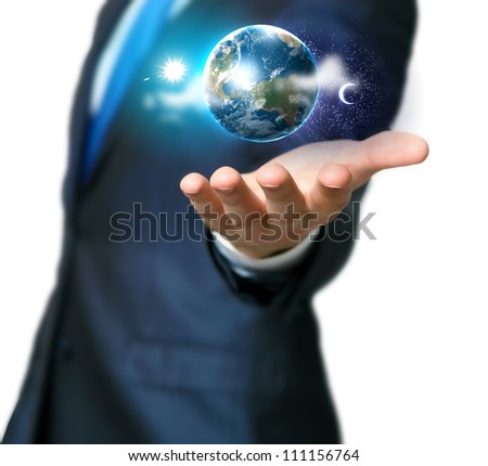 Human hand holding our planet earth glowing.Elements of this image furnished by NASA - stock photo