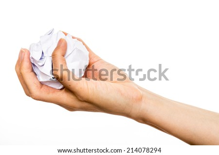 human hand holding paper ball shooting in studio