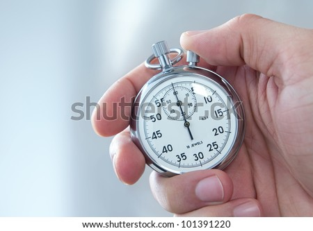 Human hand holding stopwatch - stock photo