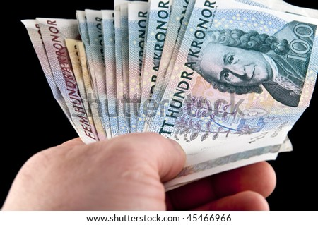 Human hand holding swedish money  / Swedish currency - stock photo