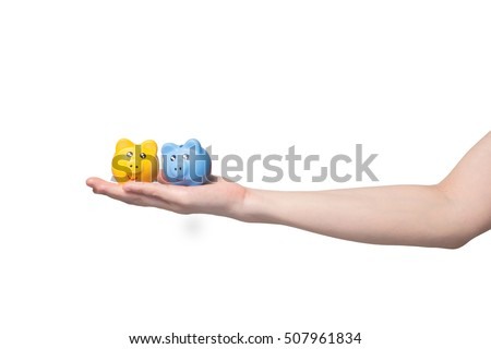 human hand holding yellow and blue sky piggy bank on isolated , Saving money for investment concept.