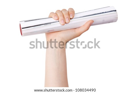 Human hand holds a rolled thick journal - stock photo