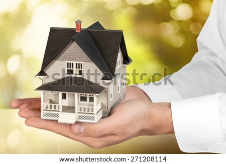 Human Hand, House, Real Estate. - stock photo