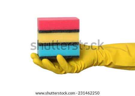 Human hand in glove holding heap of sponge, isolated on white - stock photo