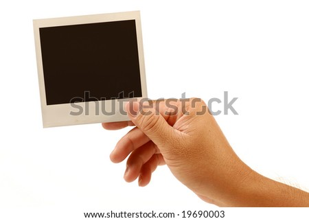 human hand is holding blank instant photo picture - stock photo