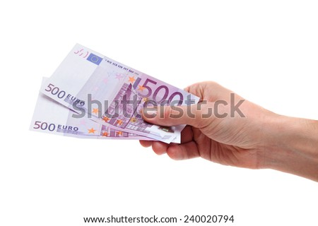 Human hand is holding two banknotes of 500's Euros.