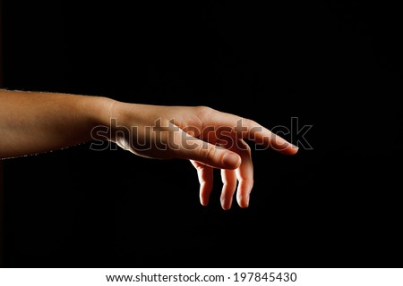 Human hand on black background
