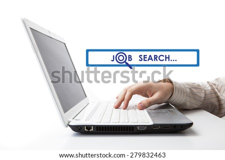 human hand on the keyboard in search of work on a white