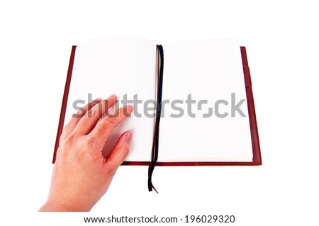 Human hand Opening notebook First Page with Leather Cover to read or write something, put your text here, isolated on white background / concept and idea. - stock photo