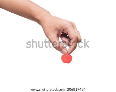 Human hand pick up piece of red apple model,isolated on white background - stock photo