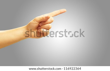 Human Hand Pointing On Gray Background - stock photo