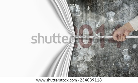 human hand pulling blank white curtain covered dark red 2014 on old mottled concrete wall background - stock photo