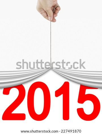 human hand pulling up curtain with bright red 2015 isolated on white background - stock photo