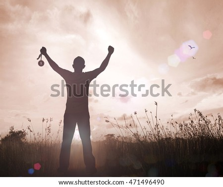Human hand raised, holding gold medal against sky. arm, win, goal, first, moon, photo, prize, best, gold, olympic, mud, hero, metal, cloud, cup, aim, game, night, sport, many, crowd, brown, sepia, one