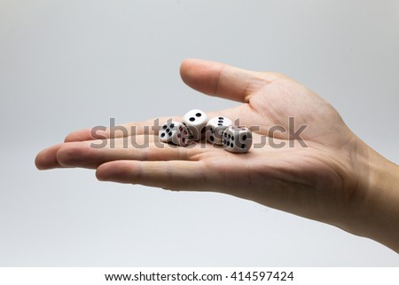 Human hand ready to roll the dice on white isolated background - Try luck, Take Risk or Business concept (Focus on dices) - stock photo