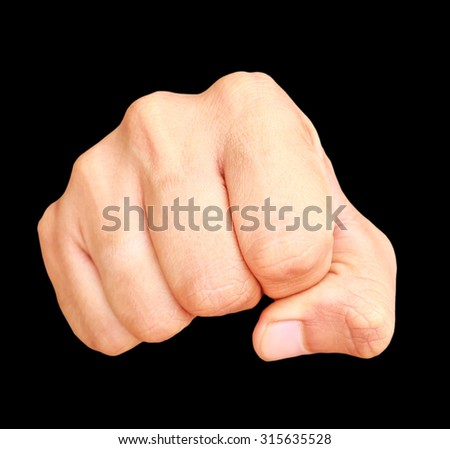 Human hand showing clenched fist on black background.