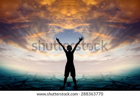 Human hand side above the background sky orange. - stock photo