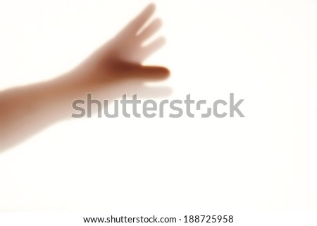 Human hand silhouette on the frosted glass, with space for text or image