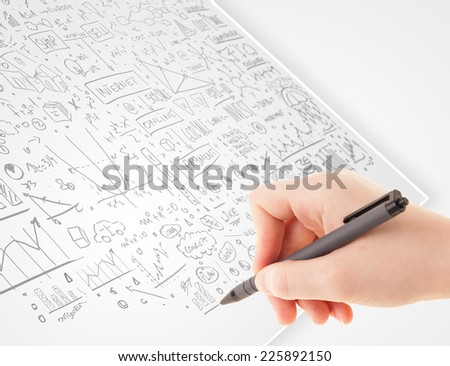 Human hand sketching multiple ideas on a paper - stock photo