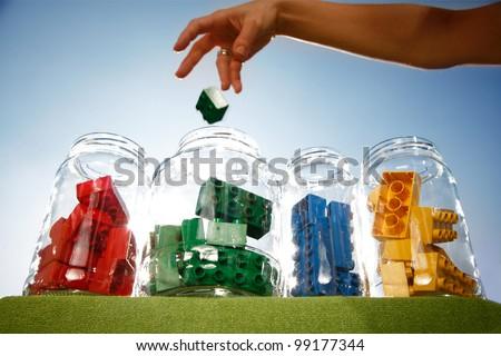 Human hand sorting color blocks - stock photo