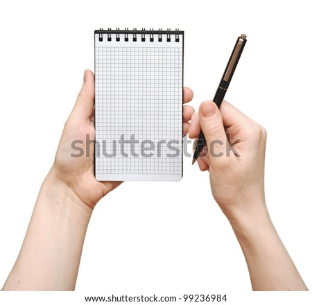 human hand take a note on blank notepad - stock photo