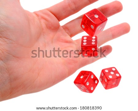 Human hand throwing dice, isolated on white background.