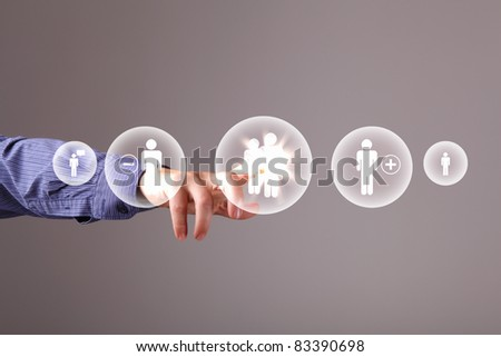 Human hand touching screen with buttons on it