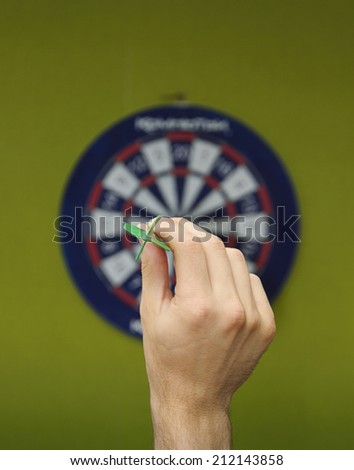 human hand with dart closeup  - stock photo