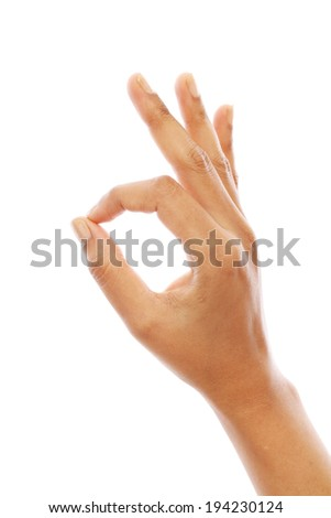 Human hand with OK gesture against white background - stock photo