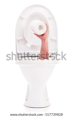 Human hand with roll of toilet paper reaches up through toilet bowl - stock photo