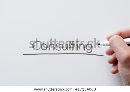 Human hand writing consulting on whiteboard - stock photo