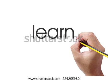 Human hand writing learn word on white background - stock photo