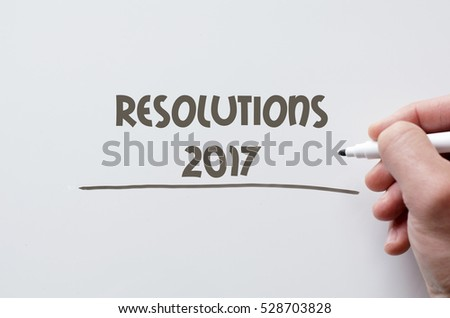 Human hand writing resolutions 2017 on whiteboard